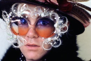 Elton John in classic feathered sunglasses.