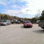 The parking lot was full of cars during the open house.