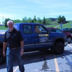 Bill Tibor outside the Lowell Larson truck