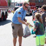 Firemen Handing Out Freezy Pops