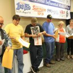 The finalists opening their station envelopes to find the grand prize