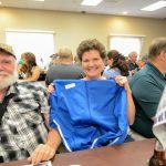 A door prize winner w/ her new jacket from the Embroidery Wearhouse