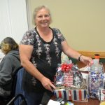Susette w/ her new gift basket from Honor Credit Union. She won for guessing 440 kisses in the jar!