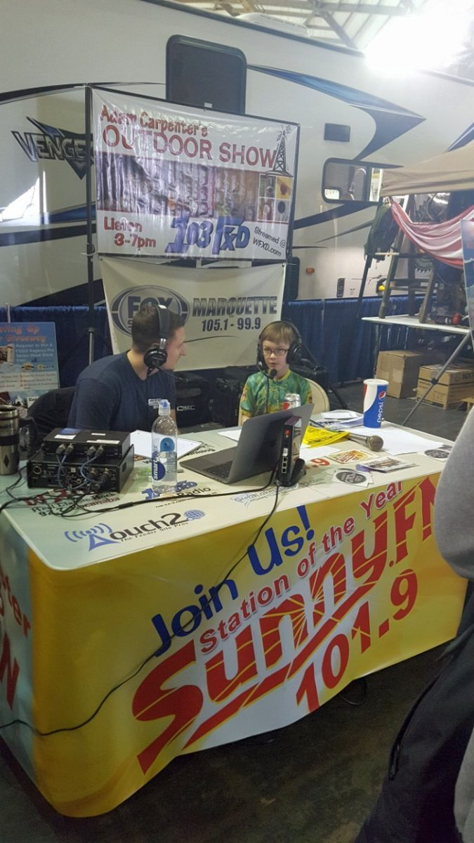 Luke G. getting the run-down on the show from a special guest