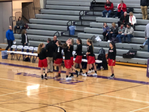 Marquette Redettes prepare to take the court against the Gladstone Braves