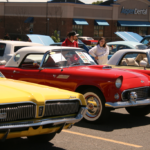 A bright red car between two bright yellow cars
