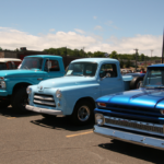 A line of blue truck at the Catch the Vision Car Show