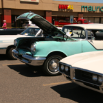 Cars lined up in the Parking Lot at the Car Show