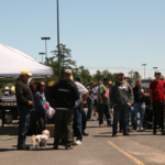 Gathered around at the Catch the Vision Car Show