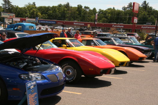 A row of cars parked at the Catch the Vision Car Show