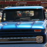 A couple drive around in their blue Chevrolet
